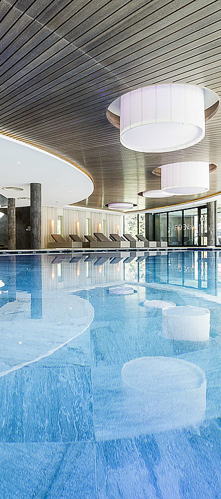 Indoor pool in the Aquagarden in the wellness hotel Sonnen Resort in South Tyrol