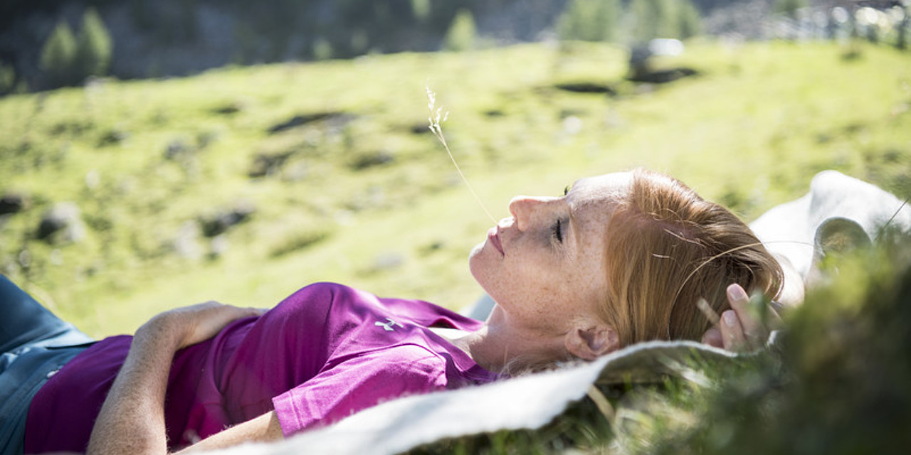 Woman enjoying the natural surroundings during a hiking and wellness holiday in Sonnen Resort Naturns